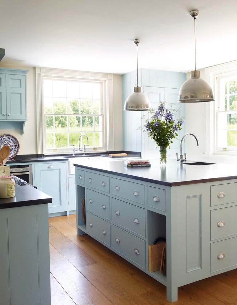 london-laos-cream-painted-kitchen-cabinets-with-traditional-faucets-and-chrome-pendants-blue